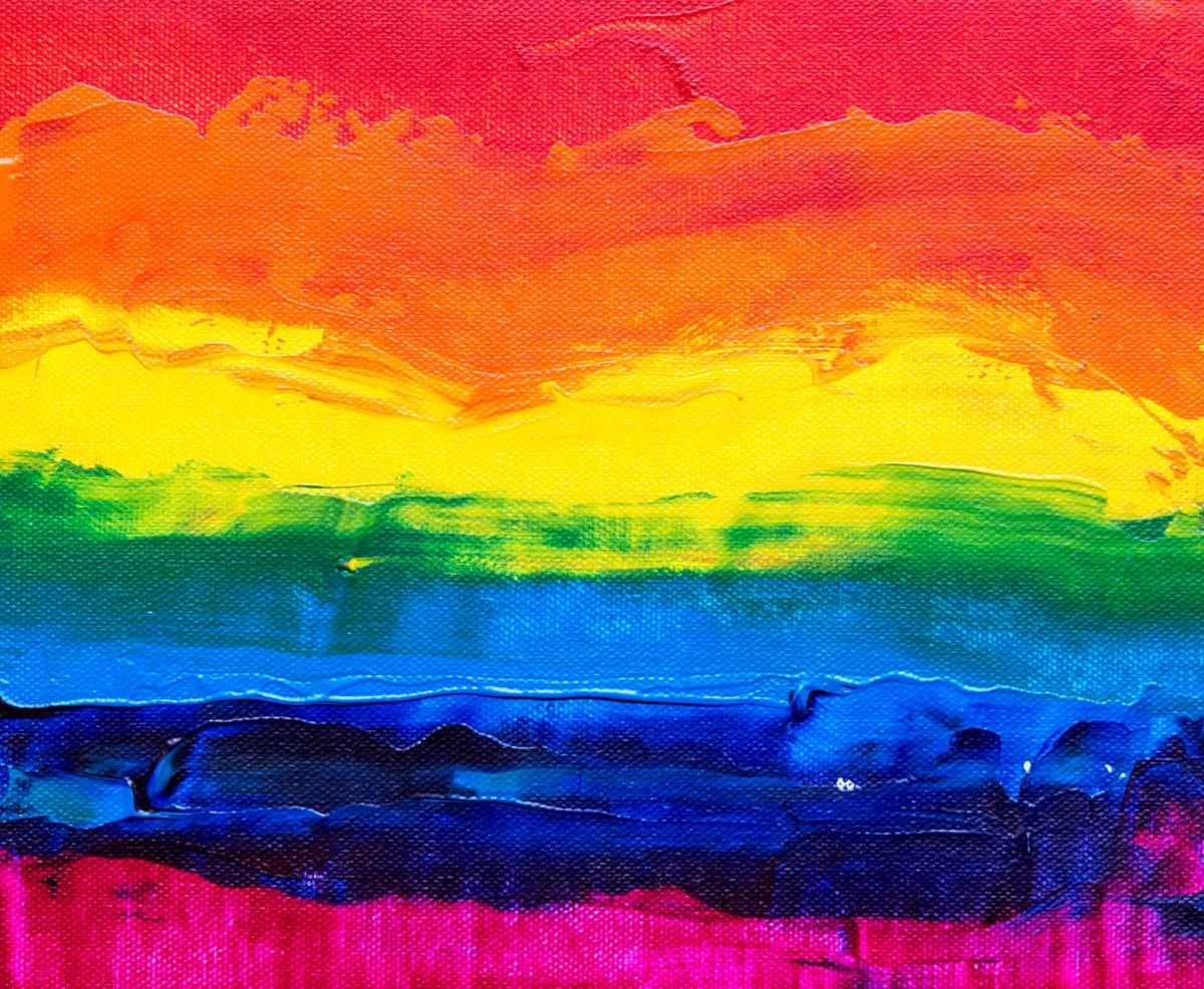 painting of rainbow colors from warm red at top down to cool fuschia